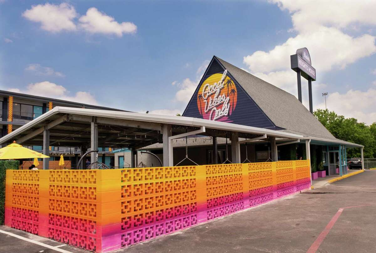 """A concrete block """"color bomb wall"""" provides privacy at the outdoor pavilion."""