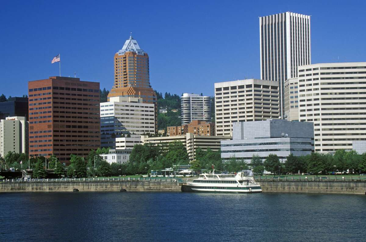 Skyline of Portland from the Willamette River, OR in morning (Photo by: Joe Sohm/Visions of America/Universal Images Group via Getty Images)