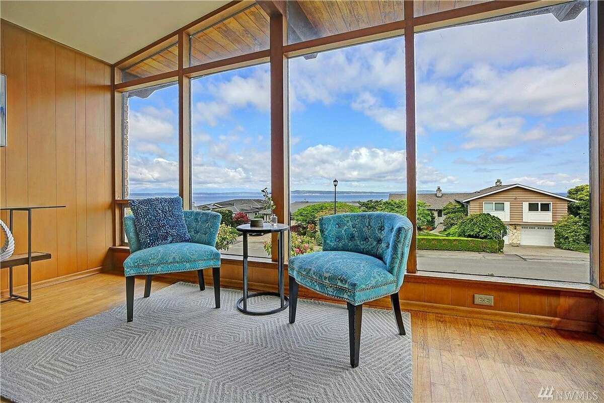 Stunning views abound in this house, framed by floor to ceiling glass here in the living room.