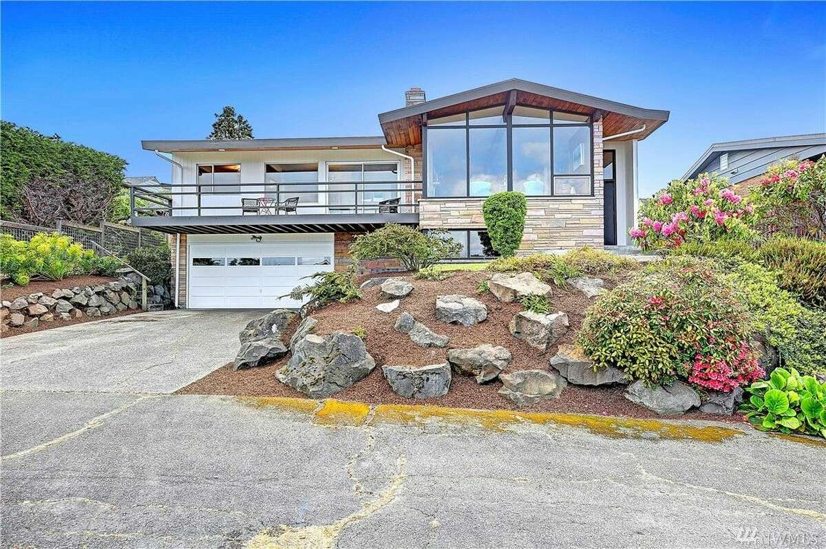 The home is frozen in time, a classic late '50s midcentury modern overlooking the water.