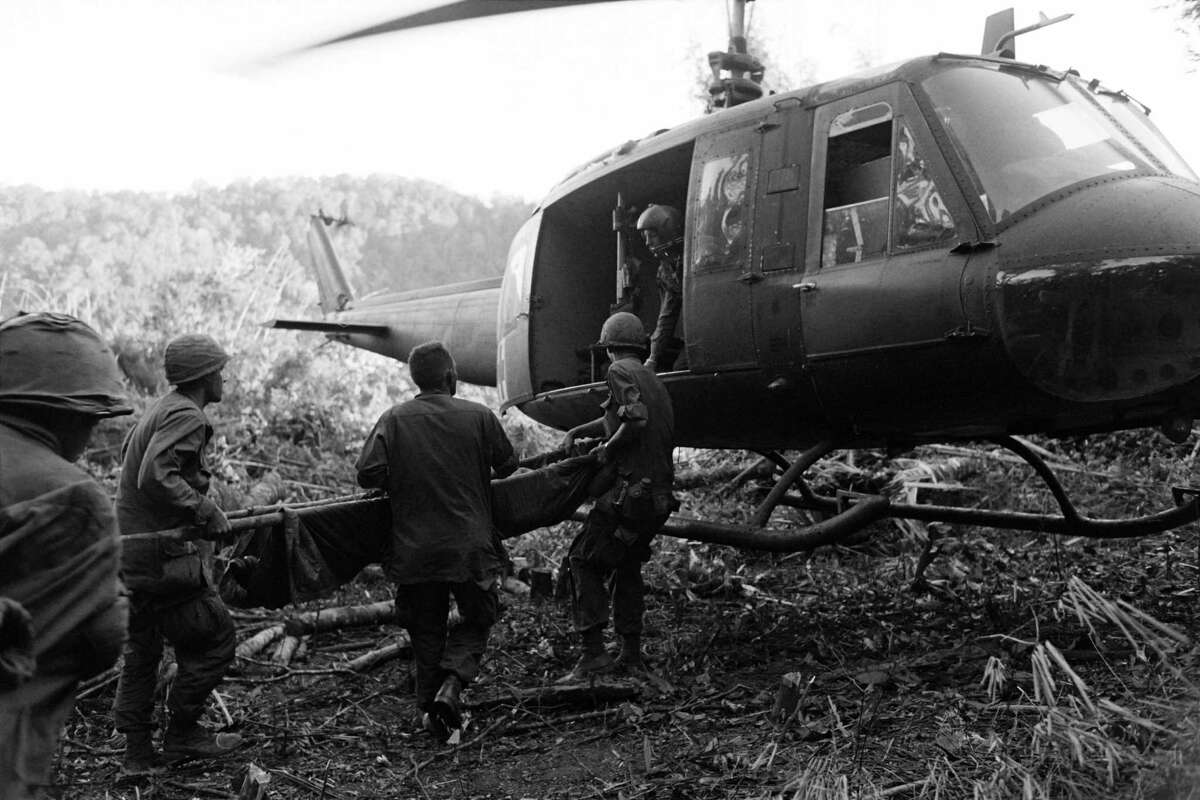 Wounded U.S. soldiers are evacuated by helicopter in Dak To in November 1967 during the Vietnam War.