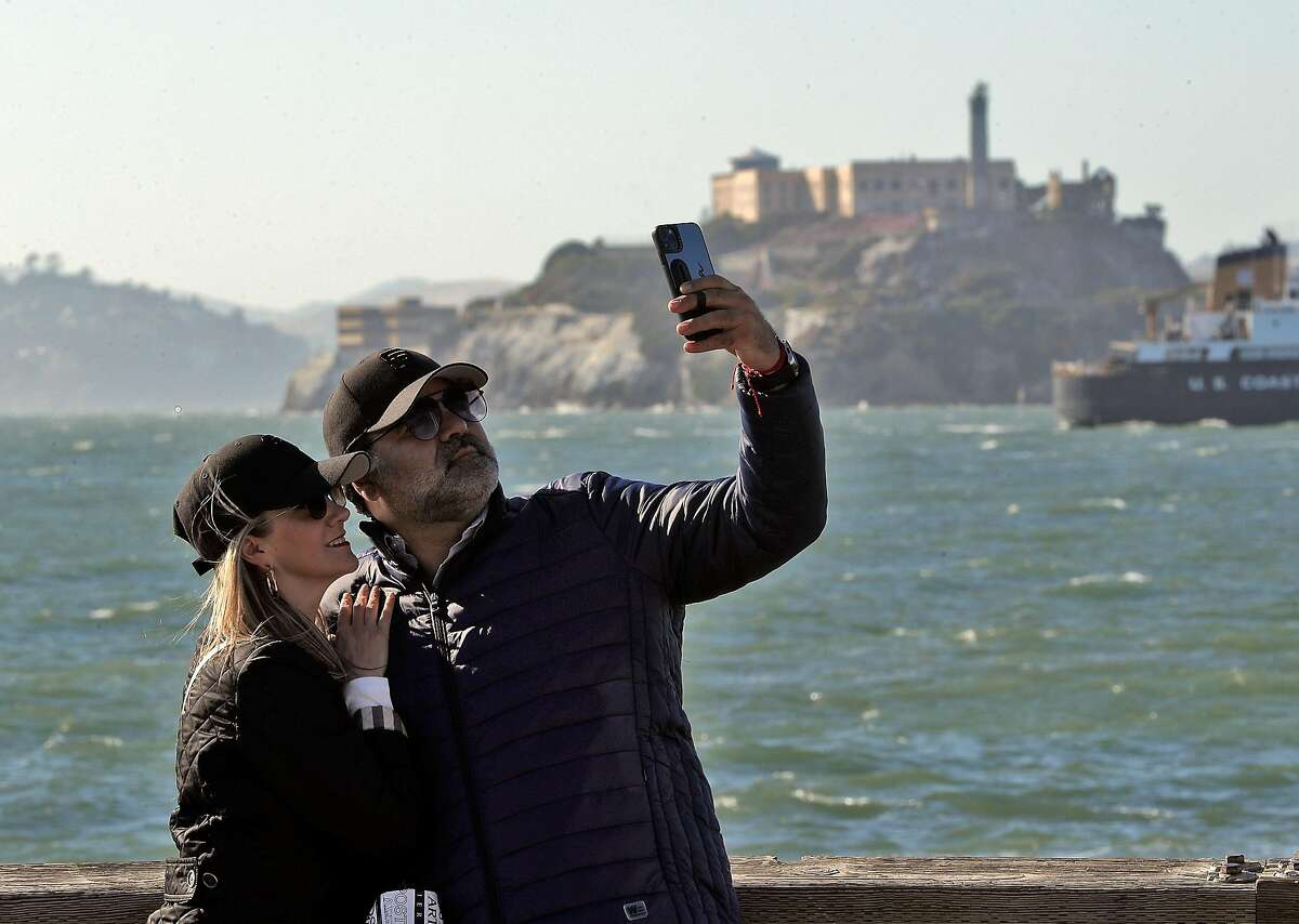 Newlyweds Jose Herrera and Aurora Aramburon, from Veracruz, Mexico, take a selfie at Pier 39 as they celebrate their honeymoon in San Francisco on May 24.