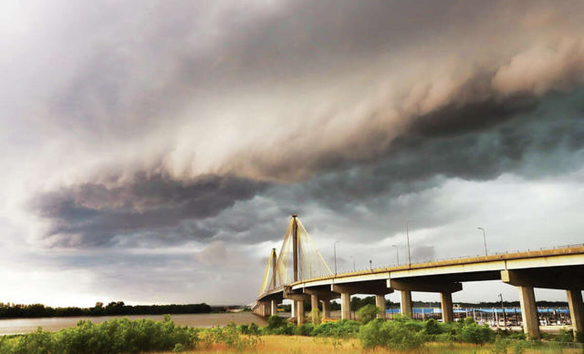 Storm clouds blow into the Alton area Thursday morning along with a tornado warning issued by the National Weather Service. No serious damage was reported but the storm blew in much cooler weather for the Memorial Day Weekend.