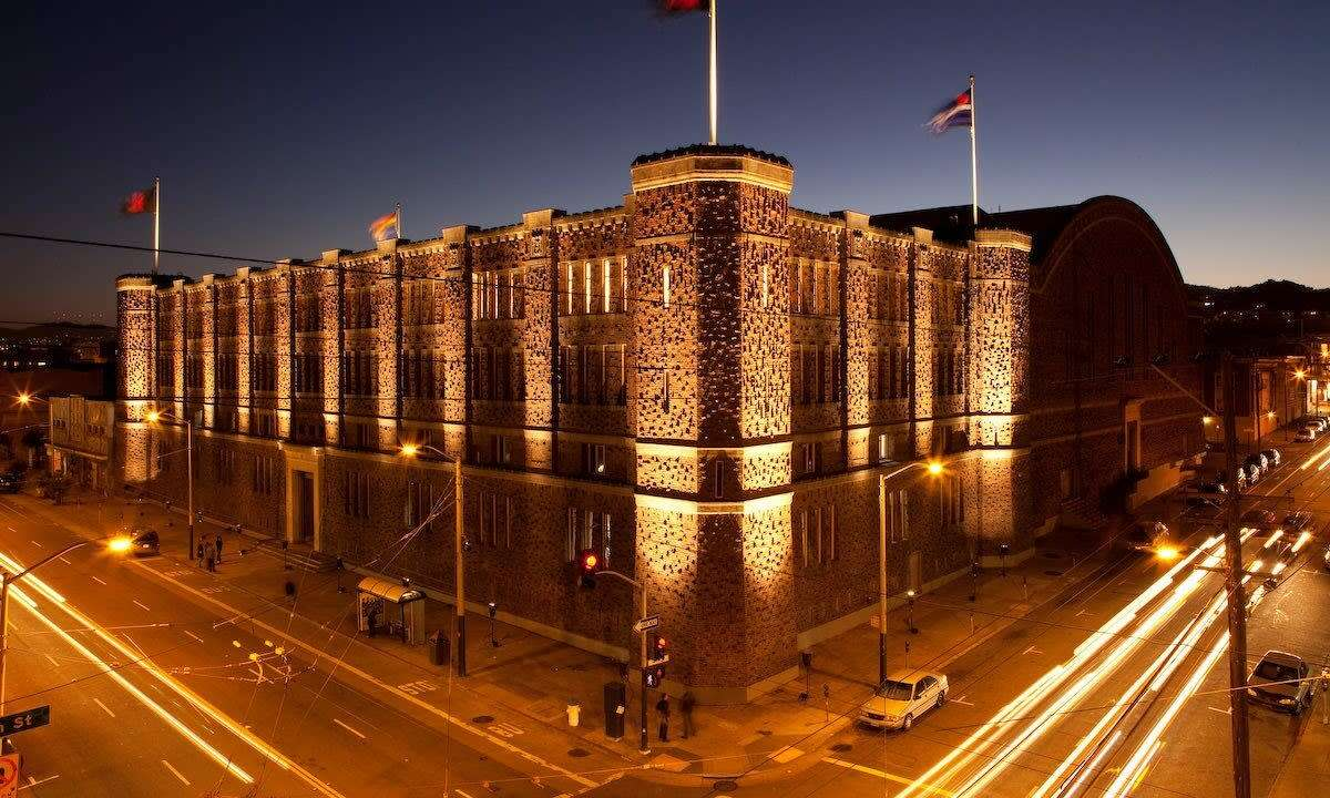 The exterior of the Armory, with the kink flag flying.