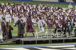 Lee High, Class of 2021 seniors make their way on stage to receive their diplomas during graduation ceremonies 5/27/2021 at Grande Communications Stadium. Tim Fischer/Reporter-Telegram