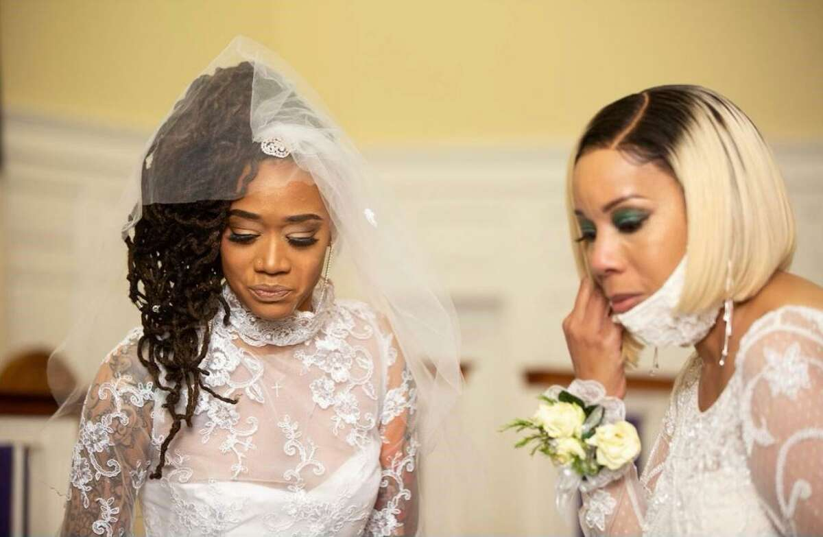 Kamiya Adams, left, moved the location of her wedding from North Carolina to Connecticut so her aunt, Sharon Moye-Johnson, right, a recent stroke victim could attend. Adams had her aunts and uncles wear ivory with a hint of green.