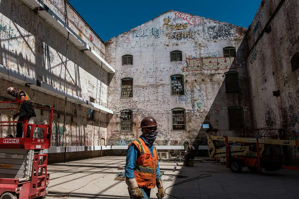 Construction workers take a look around station A at the old Potrero Power Plant, slated for redevelopment.