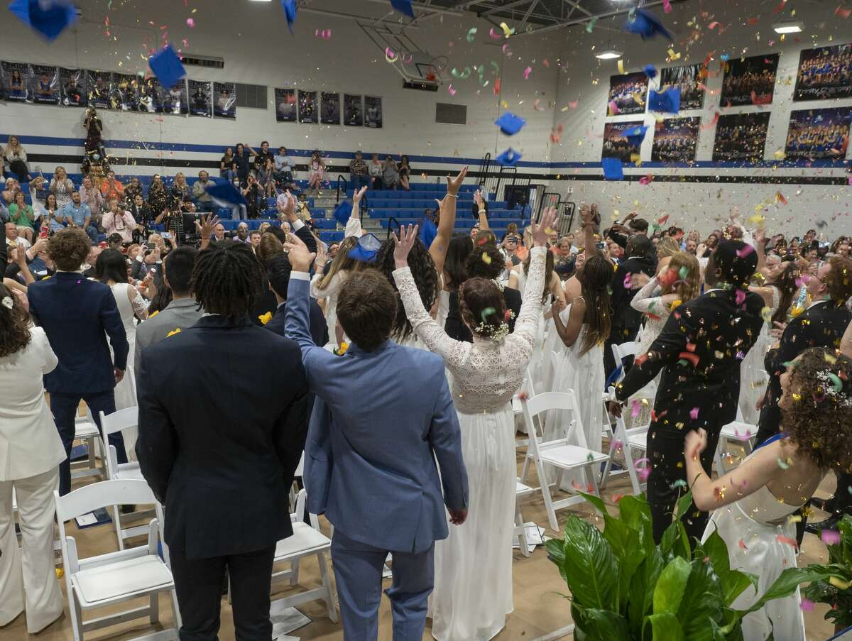 Trinity graduates toss their hat in the air as guests fire off confetti during commencement ceremonies 5/28/2021 at Trinity School. Tim Fischer/Reporter-Telegram