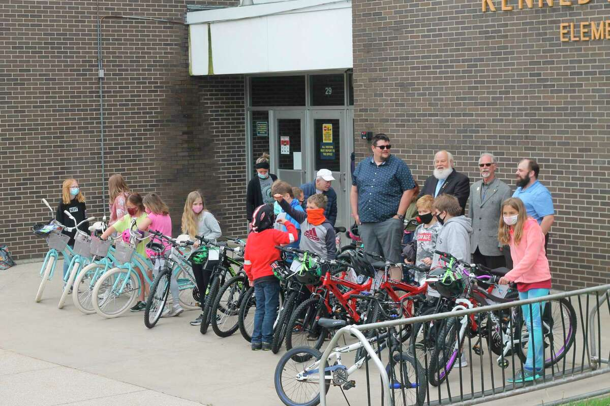 Kennedy Elementary students pick out the bicycles awarded to them by the Manistee Masonic Lodge No. 228 Friday morning through the Bikes for Books program. (Kyle Kotecki/News Advocate)