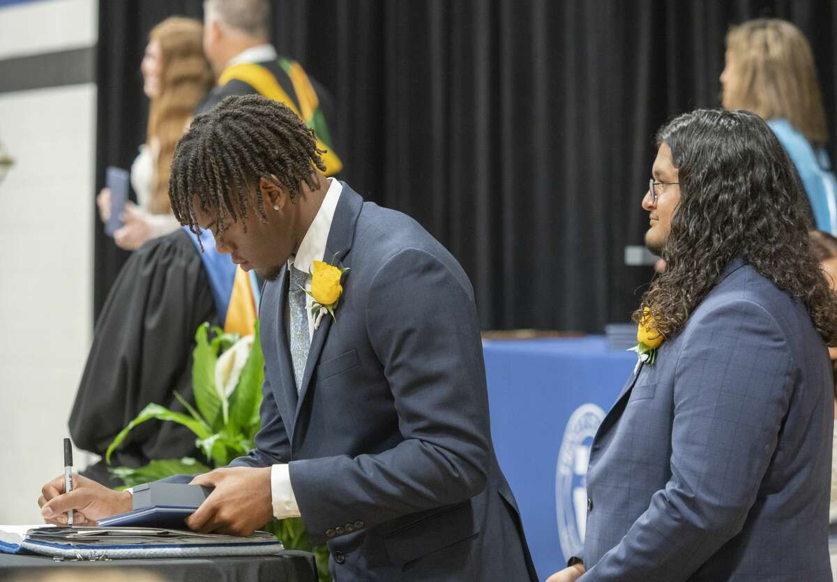 Trinity seniors make their was across the stage to receive their diploma during commencement ceremonies 5/28/2021 at Trinity School. Tim Fischer/Reporter-Telegram