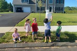 The children of residents on Mikey's Way in North Haven pose in front of a mailbox. Residents of the road have been frustrated that the post office won't deliver directly to their homes. From left, Matteo Cusano, Olivia Kowaleski, Alex Kowaleski, Zion Chun and Eden Chun.