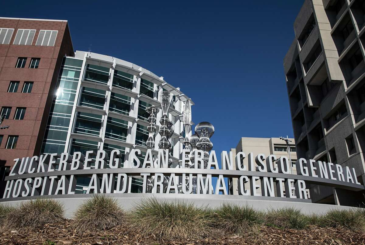 Two Asian American staff members at San Francisco General Hospital were assaulted Monday in what authorities are investigating as a racially motivated attack.