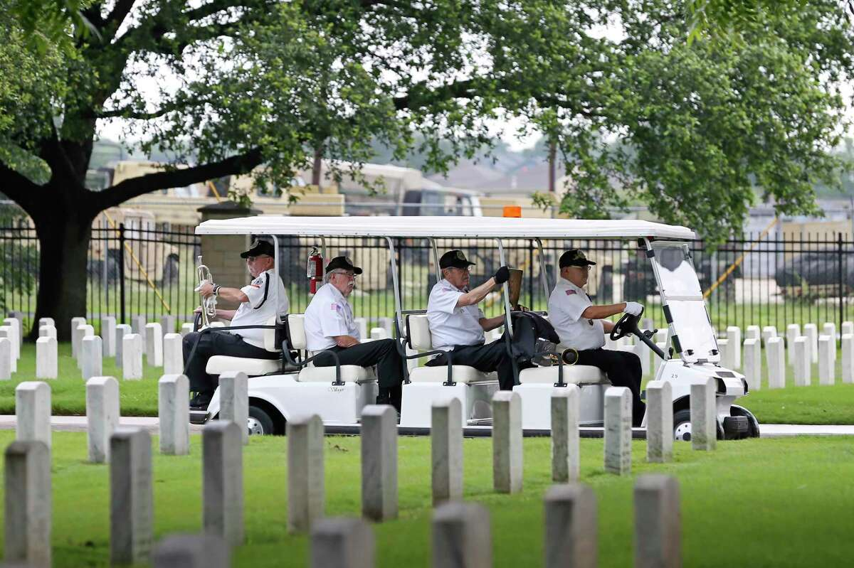 Members of the Fort Sam Houston Memorial Services Detachment, including buglers Mike Kinkade, left, and Robert Ramirez, driving, make their way to Shelter No. 2 for a service last week.