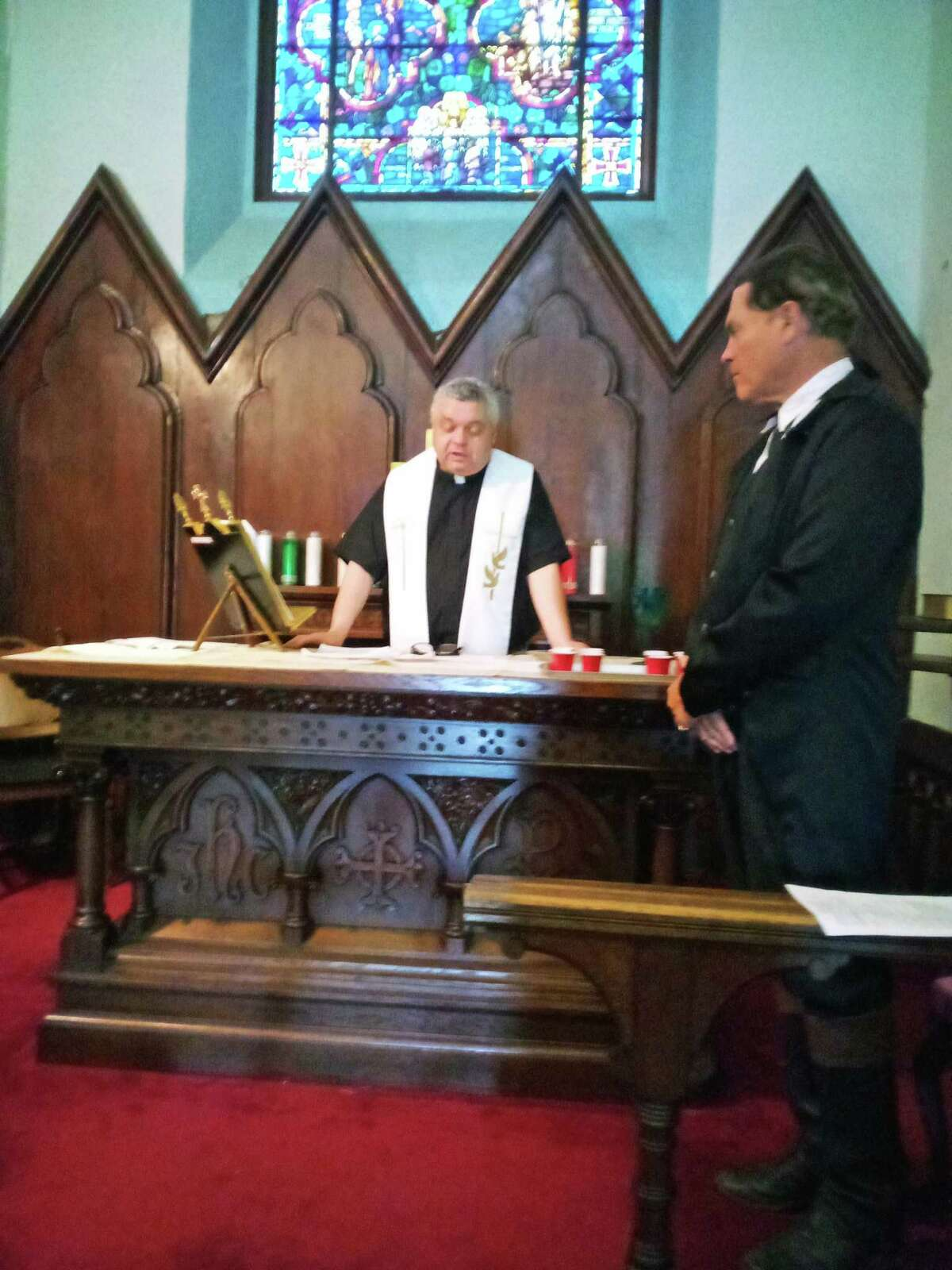 The Rev. Alex Gorecki leads worship at Christ Church in Canaan, with church warden and historic reenactor Kevin Titus.