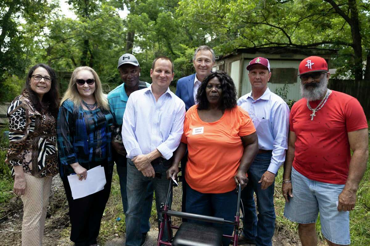 Odessa Sneed, center, poses for a portrait with local officials outside her home during a Community Development Block Grant Housing Tour, Thursday, May 27, 2021, in Conroe. Sneed's property has been in the family for generations.