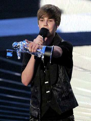 LOS ANGELES, CA - SEPTEMBER 12:  Singer Justin Bieber accepts the Best New Artist award onstage during the 2010 MTV Video Music Awards at NOKIA Theatre L.A. LIVE on September 12, 2010 in Los Angeles, California.  (Photo by Kevin Winter/Getty Images) *** Local Caption *** Justin Bieber Photo: Kevin Winter, Getty Images / 2010 Getty Images