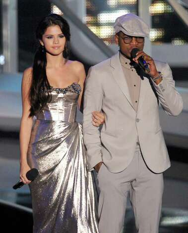 LOS ANGELES, CA - SEPTEMBER 12:  Actress Selena Gomez (L) and singer Ne-Yo speak onstage during the 2010 MTV Video Music Awards at NOKIA Theatre L.A. LIVE on September 12, 2010 in Los Angeles, California.  (Photo by Kevin Winter/Getty Images) *** Local Caption *** Selena Gomez;Ne-Yo Photo: Kevin Winter, Getty Images / 2010 Getty Images