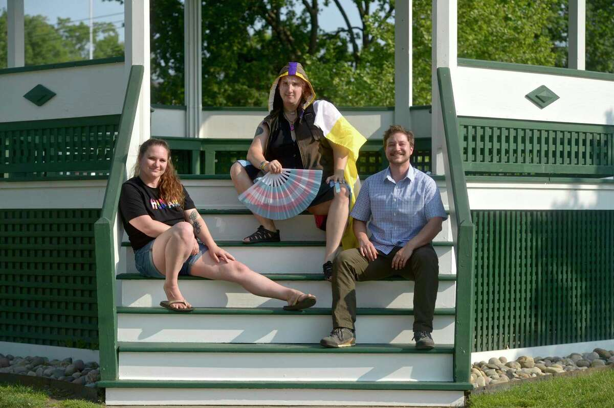 Lauren Burke, left, of Gaylordsville, Dez Noa Volnixshin, of New Milford, and Adam Murphy, of New Milford, have planned a Pride picnic to be held on the town green on June 12 of this year. Wednesday, May 26, 2021, in New Milford, Conn.