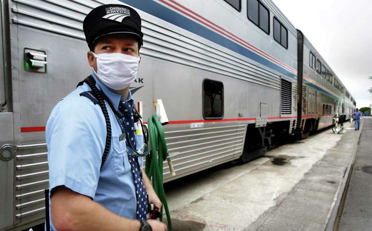 Amtrak Conductor Michael Moilanen check the train before it pulls out of the station in San Antonio. Amtrak is proposing increased intercity rail service in Texas as part of a nationwide plan.