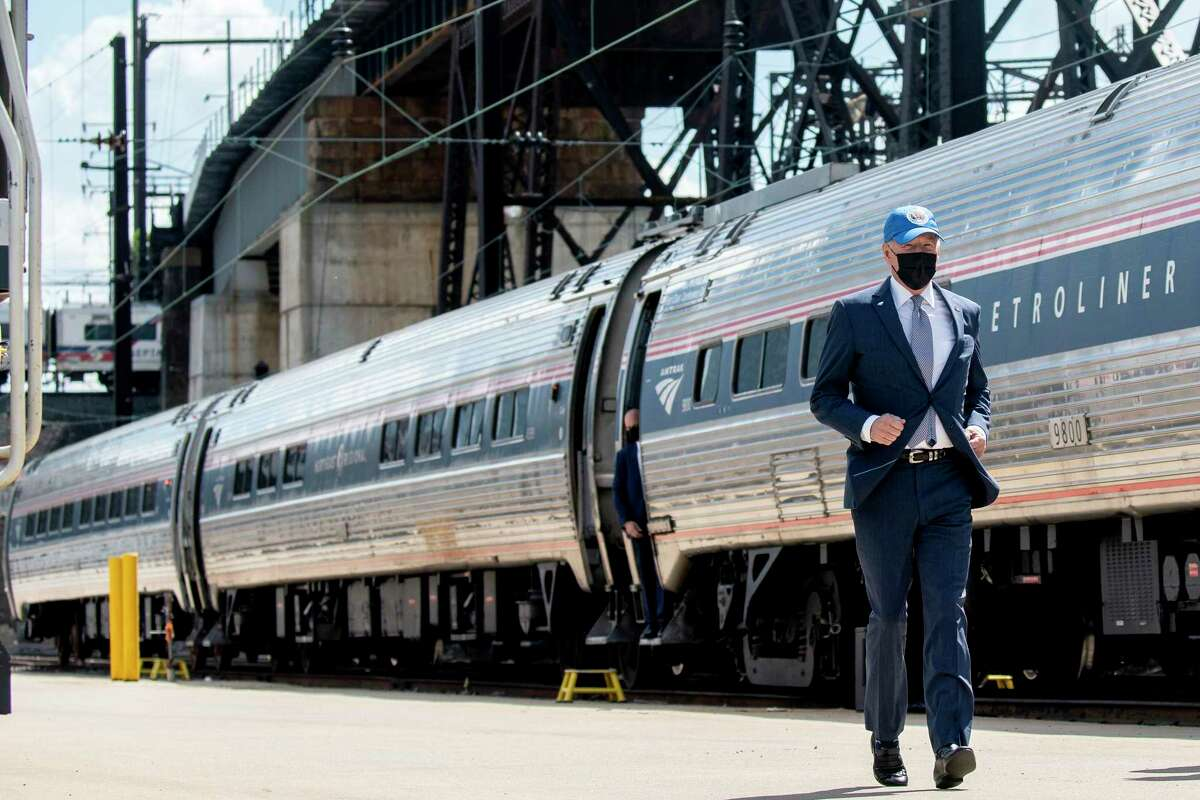 President Joe Biden runs to speak at an event marking Amtrak's 50th anniversary, in Philadelphia, on April 30, 2021. For the majority of his political career, Biden was a rail commuter, making the 90-minute Amtrak Metroliner trip between Washington and his home in Wilmington, Delaware, when the Senate was in session.