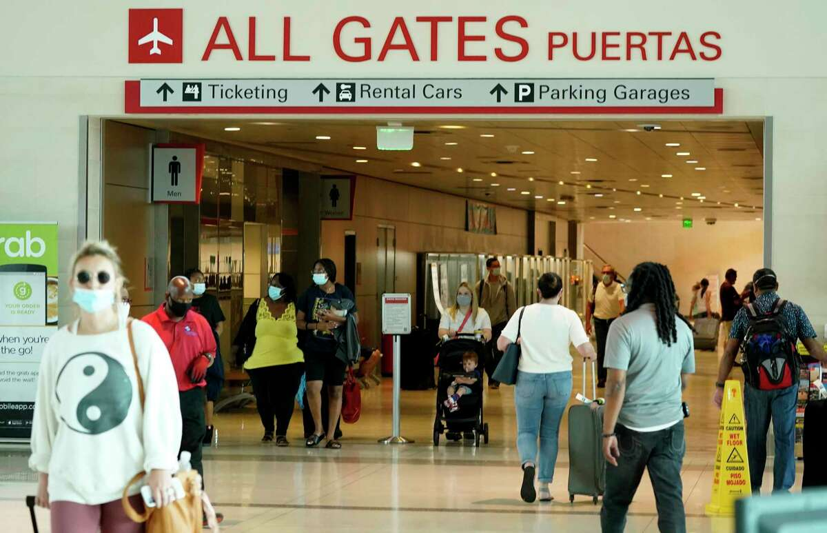 People make their way through Love Field airport Friday, May 28, 2021, in Dallas. (AP Photo/LM Otero)