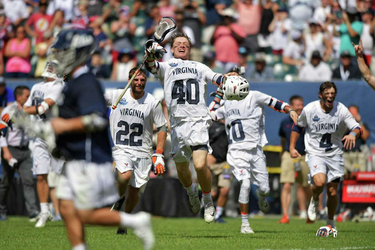 Ryan Conrad (22), Ryan Lamb (40), Xander Dickson (10) and Jeff Conner (4) of the Virginia Cavaliers run onto the field after beating the Yale Bulldogs, 13-9, for the NCAA Championship at Lincoln Financial Field in 2019 in Philadelphia.