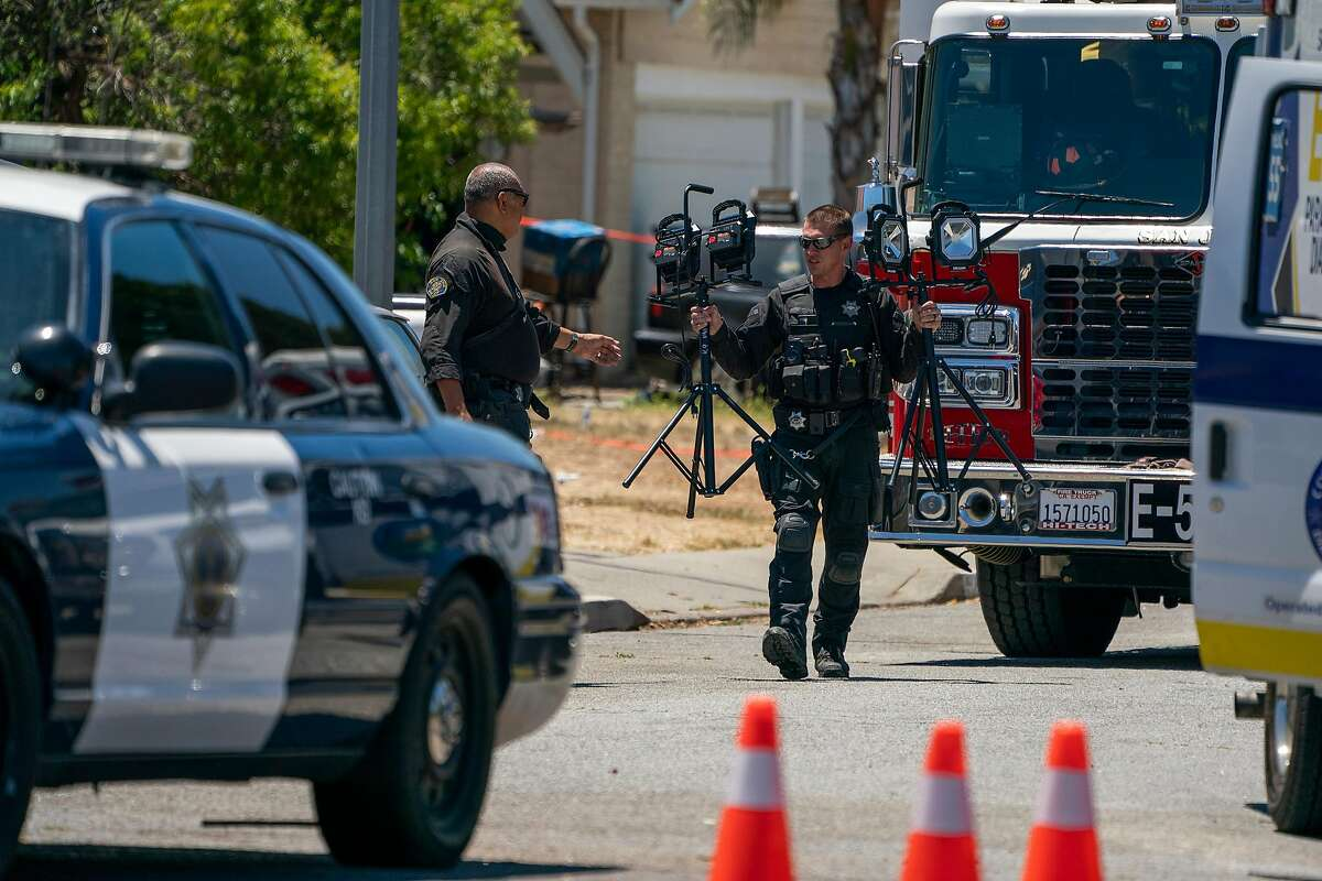 San Jose Police Department officers leave Samuel Cassidy's home in San Jose.