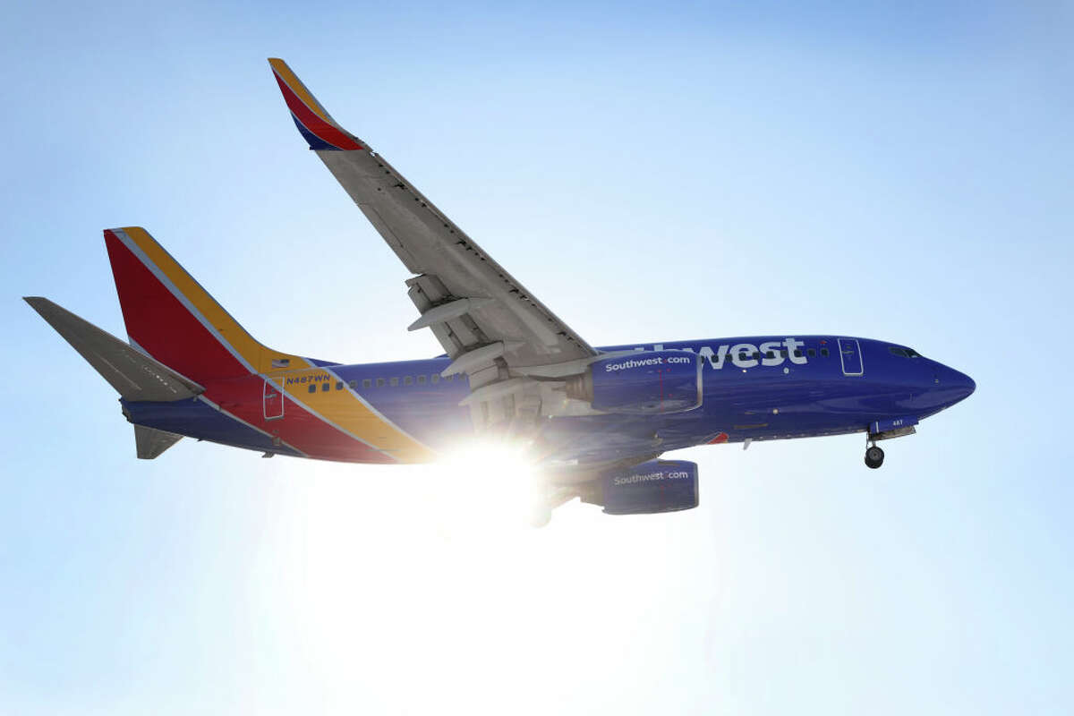 A Southwest Airlines jet lands at Midway International Airport on Jan. 28, 2021, in Chicago, Ill.