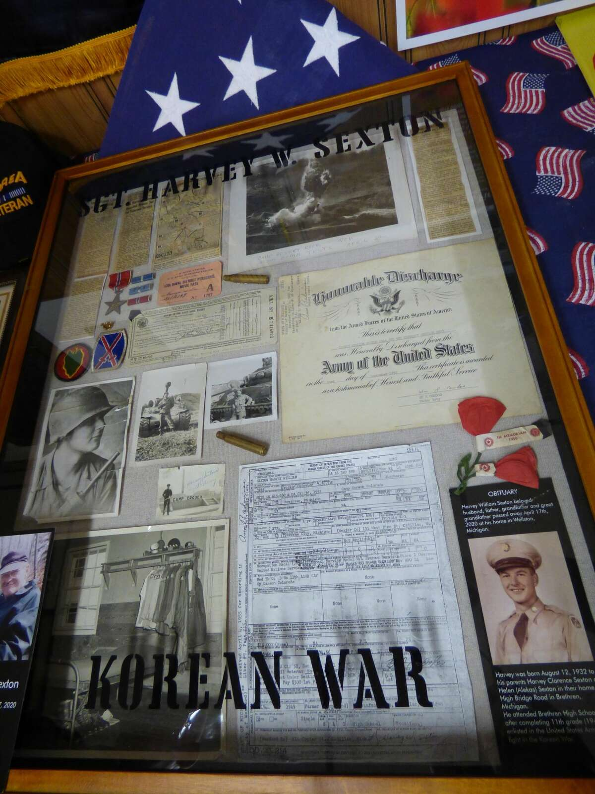 A memorial shadowbox on display at Kaleva VFW post No. 6333 holds mementos from Sgt. Harvey Sexton's time in the service.