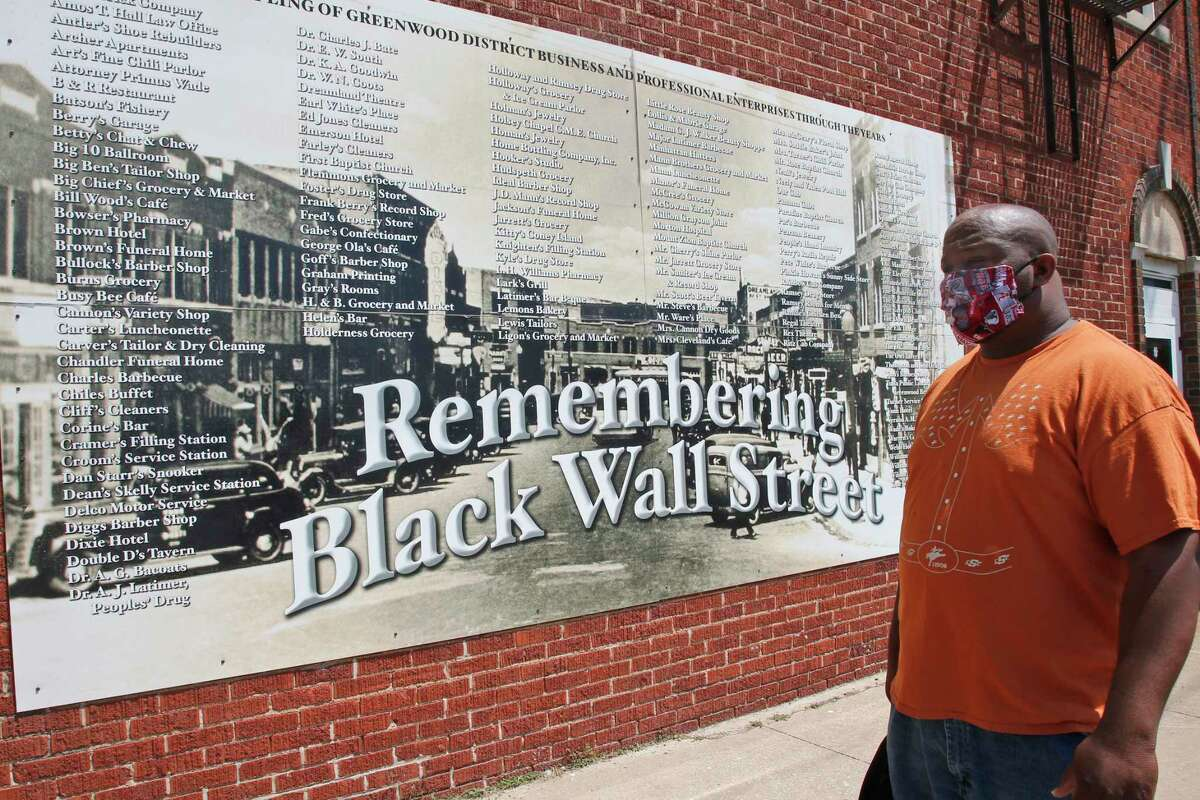 A mural lists the businesses destroyed during the Tulsa race massacre. It's been 100 years, and the full history is only now widely acknowledged.