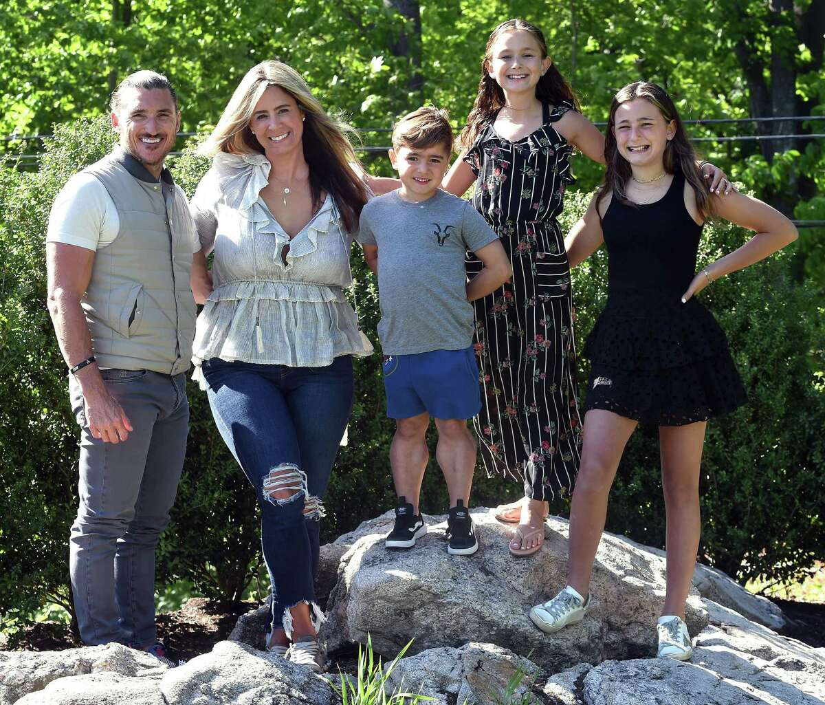 From left, Jesse and Stephanie Herzog with their children Max, 5, Vita, 9, and Stella, 11, at their home in Branford on May 24, 2021.