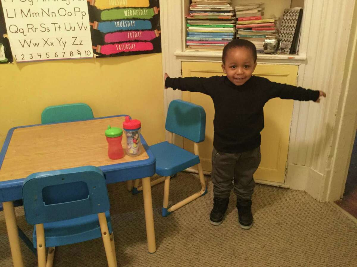 Children learn and play at Queen Freelove's day care in New Haven.