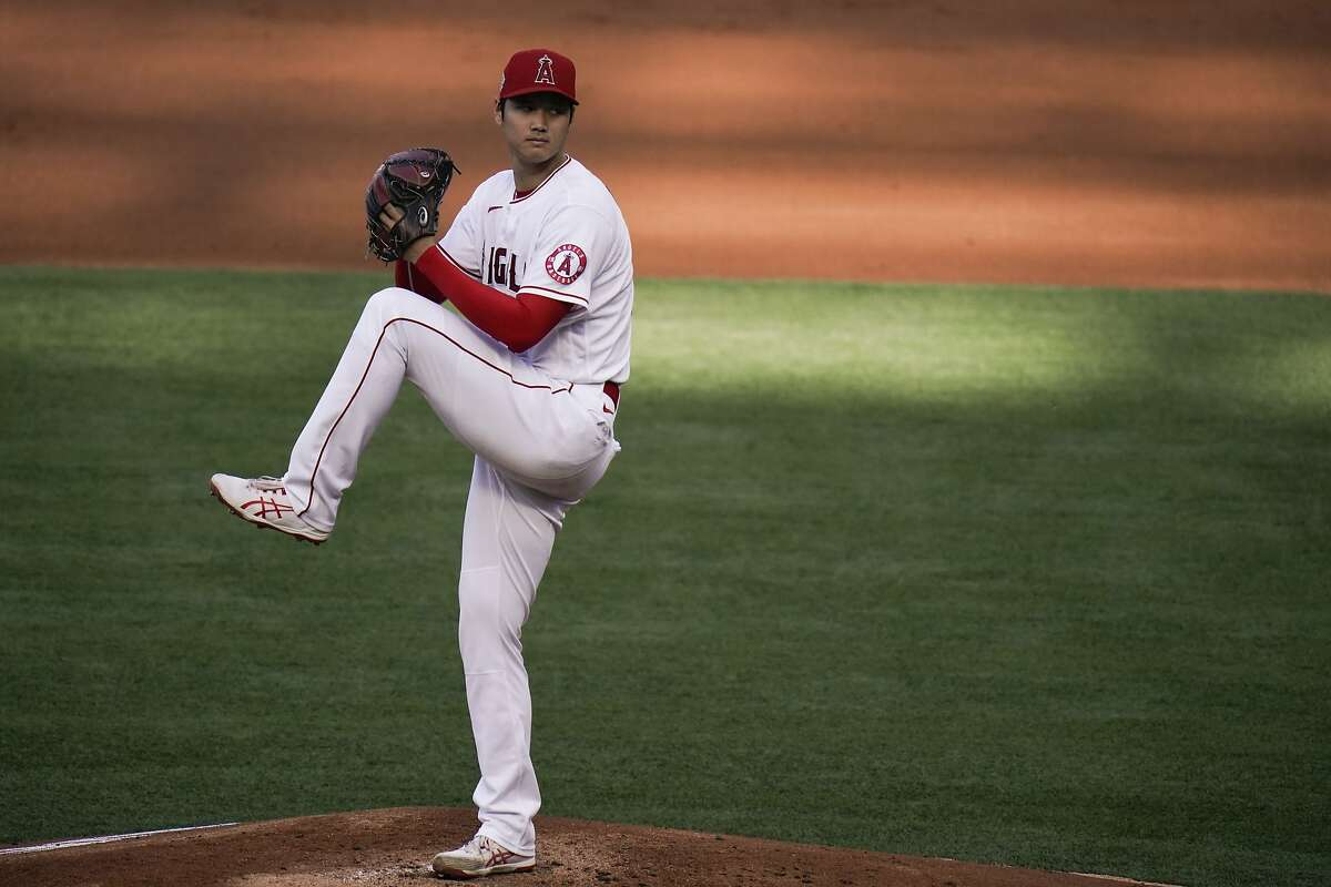 Los Angeles Angels starting pitcher Shohei Ohtani, of Japan, winds up to throw against the Cleveland Indians during the first inning of a baseball game, Wednesday, May 19, 2021, in Anaheim, Calif. (AP Photo/Jae C. Hong)