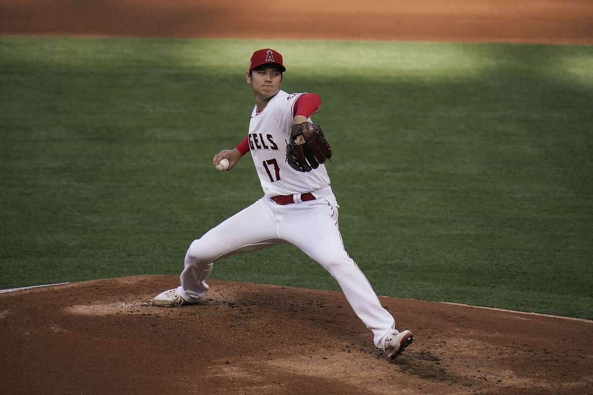 Los Angeles Angels starting pitcher Shohei Ohtani, of Japan, throws against the Cleveland Indians during the first inning of a baseball game, Wednesday, May 19, 2021, in Anaheim, Calif. (AP Photo/Jae C. Hong)