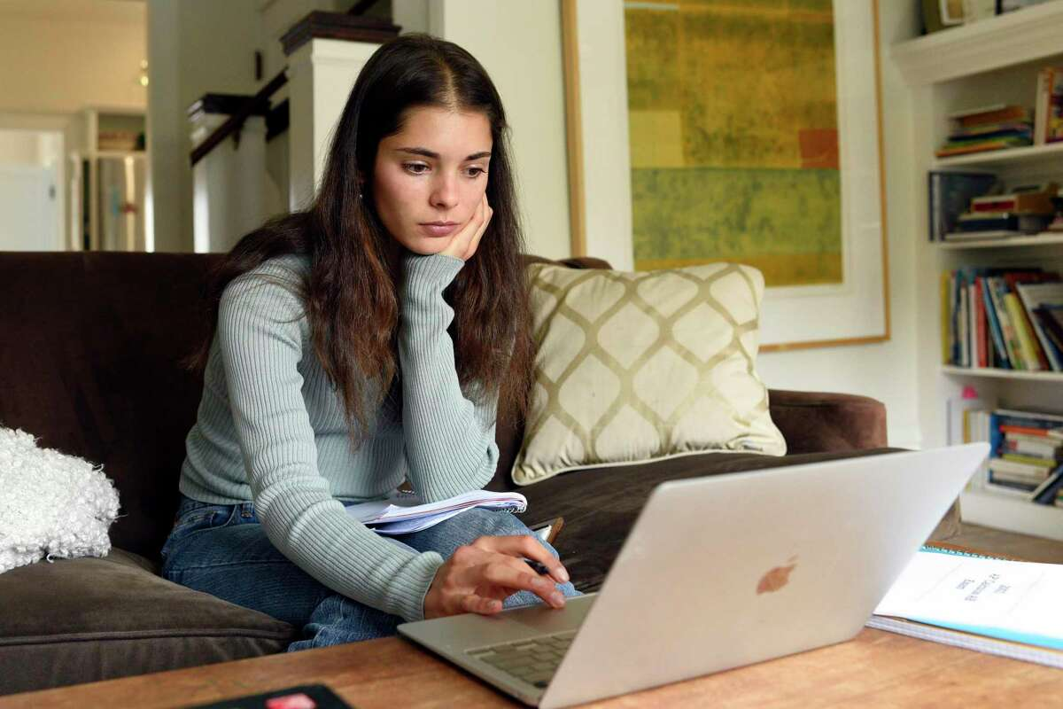 Lowell High School senior Natalia Potente sits in her online AP Comparative Government class at her home in San Francisco. on Tuesday, May 11.