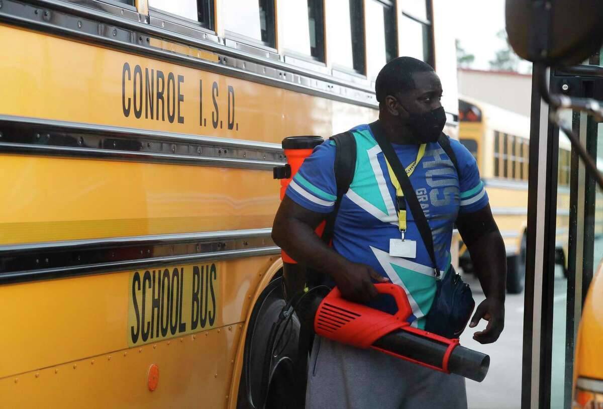 Bus driver Ahmari Childs sprays a disinfecting mist at the end of the day at one of Conroe ISD's four transportation center, Wednesday, Sept. 9, 2020, in Oak Ridge. On June 3, the CISD transportation department will be hosting a job fair from 8 a.m. to 1 p.m. at two locations, the Conroe Transportation Center at 108 Gladstell Street in Conroe and the Oak Ridge Transportation Center at 27110 Geffert Wright Road in Spring.