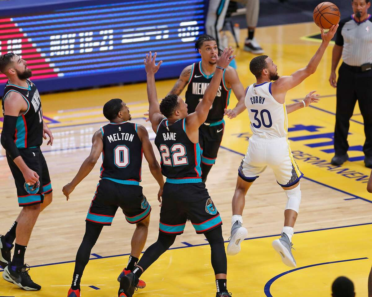Golden State Warriors' Stephen Curry scores against the Memphis Grizzlies at Chase Center in San Francisco, Calif., on Sunday, May 16, 2021.