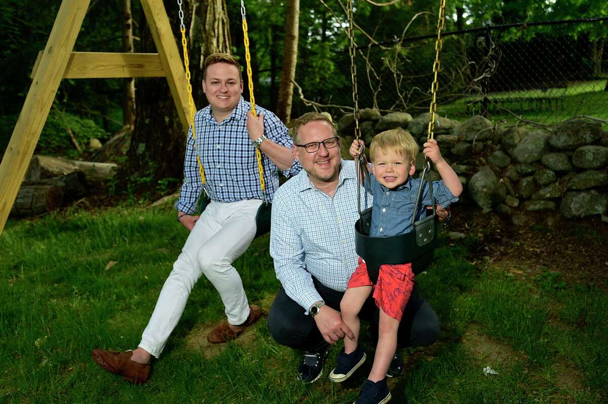 Brian McGunagle, center, with his husband, Steven Gustafson, and son, Henry McGunagle-Gustafson, 2, at their home in Westport on Tuesday, May 25. McGunagle, a longtime Westport resident is the mastermind behind the town's first ever Pride Month.