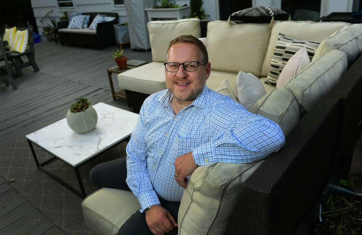 Brian McGunagle, a longtime Westport resident who was the mastermind behind the town's first ever Pride Month, at his home Tuesday, May 25, 2021, in Westport, Conn.