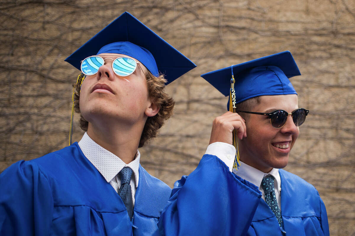 Cameron Gardner, left, and Brady Gardner, right, wait to enter Dow Diamond as the Midland High School Class of 2021 celebrate with a commencement ceremony Friday, May 28, 2021 in Midland. (Katy Kildee/kkildee@mdn.net)