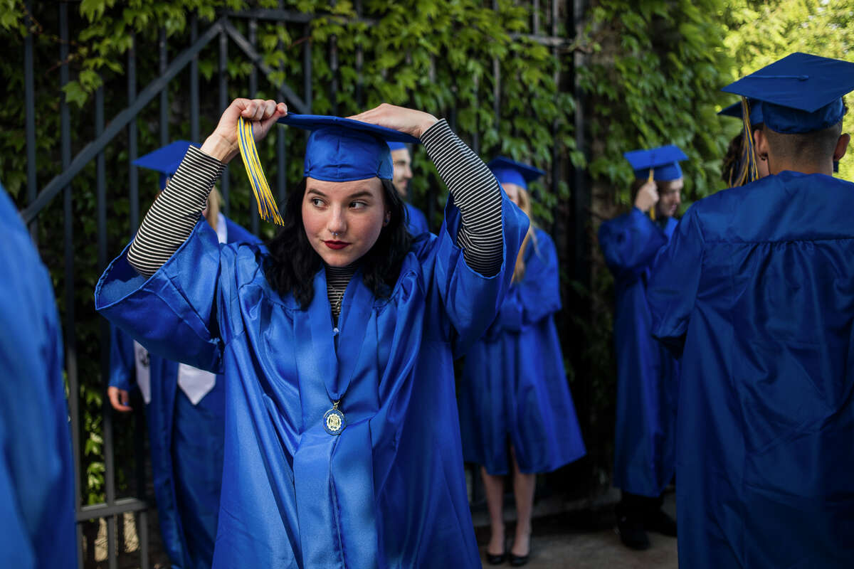 Graduating senior Anna Dorrien fixes her tassel as the Midland High School Class of 2021 celebrate with a commencement ceremony Friday, May 28, 2021 at Dow Diamond in Midland. (Katy Kildee/kkildee@mdn.net)