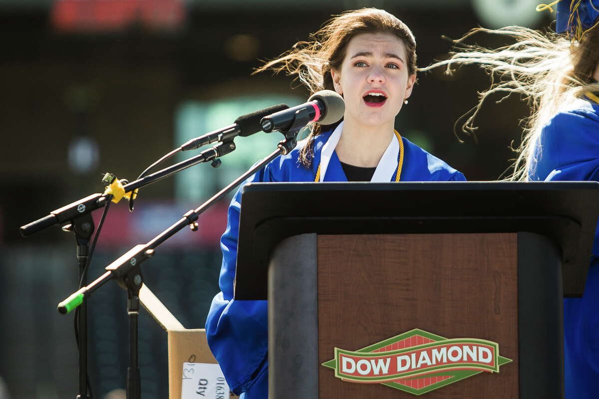 Emma Massey sings the national anthem as the Midland High School Class of 2021 celebrate with a commencement ceremony Friday, May 28, 2021 at Dow Diamond in Midland. (Katy Kildee/kkildee@mdn.net)