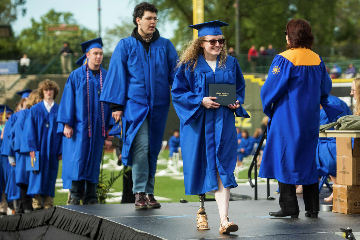The Midland High School Class of 2021 celebrate with a commencement ceremony Friday, May 28, 2021 at Dow Diamond in Midland. (Katy Kildee/kkildee@mdn.net)