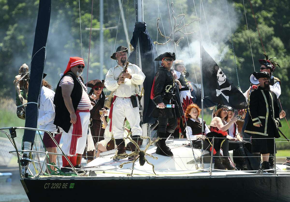 A crew of swarthy pirates arrive by ship at Lisman Landing on Milford Harbor during the Pirate's Day festivities in Milford, Conn. on Sunday, June 9, 2019.