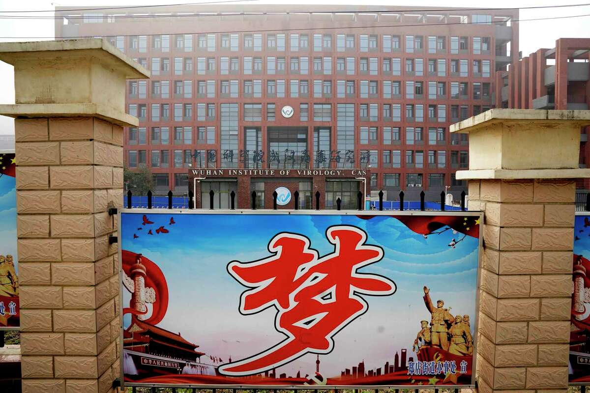 The Wuhan Institute of Virology is seen near the Chinese character for
