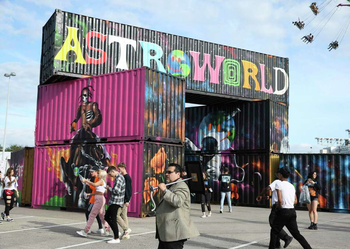 Astroworld Festival-goers like to take photographs of the murals on the shipping container at NRG Park on Saturday, Nov. 17, 2018, in Houston.
