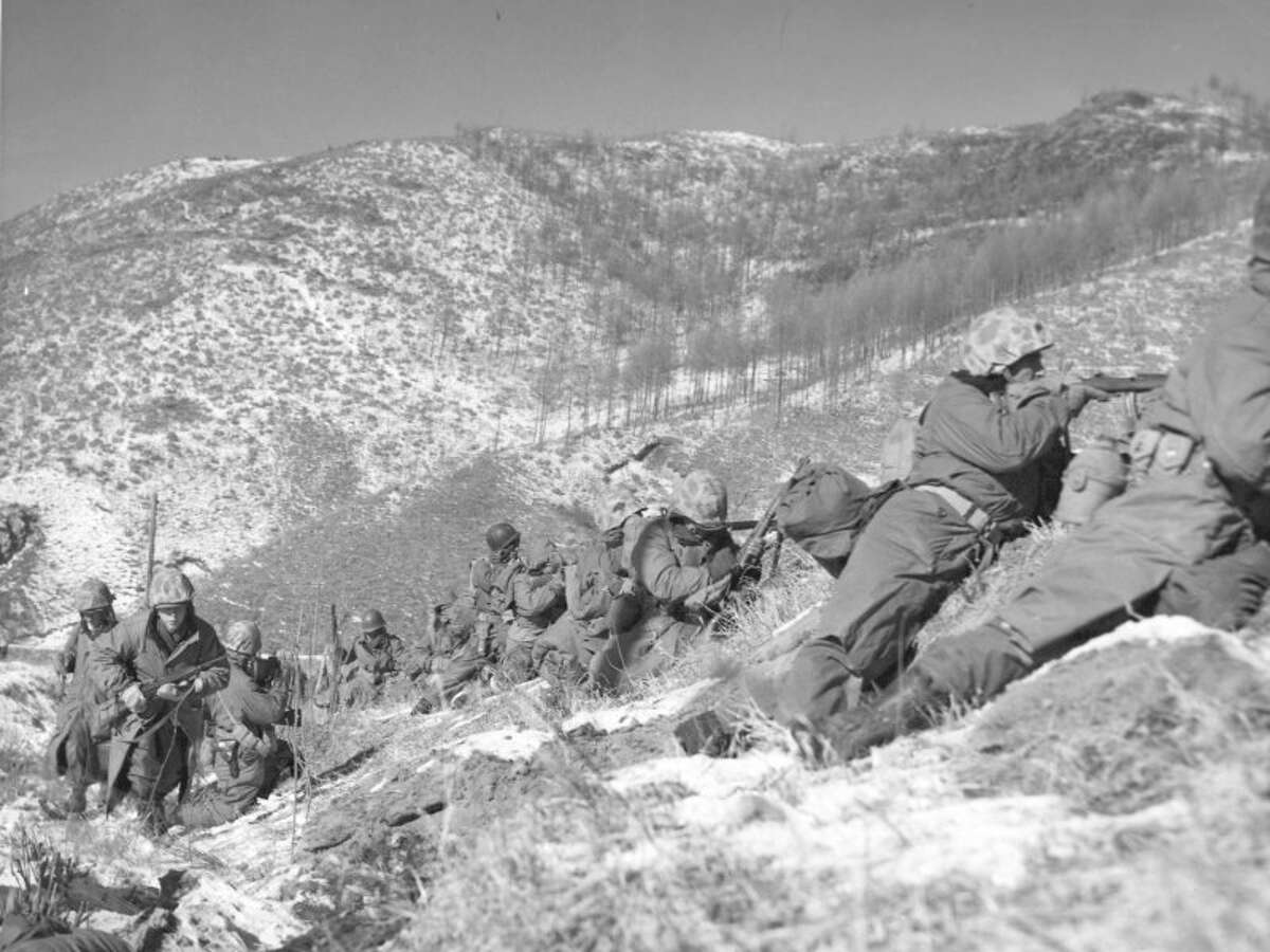 Marines hold off an attack by Chinese forces at Chosin Reservoir in the Korean War. Army soldier Clifford Johnson, one of three brother from Valatie who fought in three different wars, was killed in Korea in 1950. ( Sgt. Frank Kerr / Marine Corps )