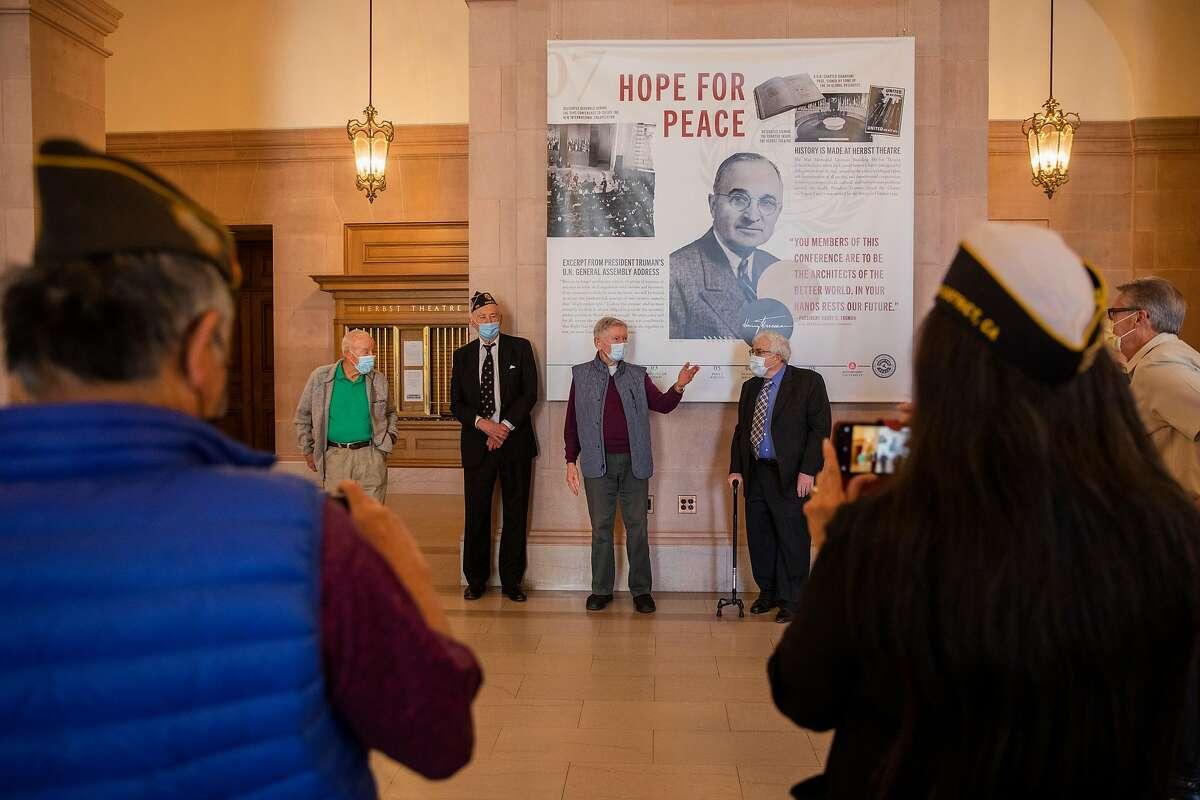 Maj. Gen. J.M. Myatt (left), retired Judge Quentin Kopp, Ken Maley and Dana Lombardi speak at the Veterans War Memorial Building unveiling of banners depicting local World War II history.