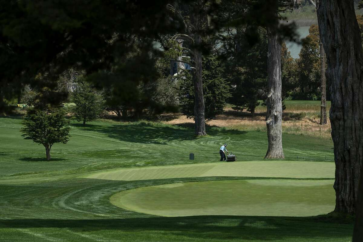 Groundskeepers tend to the greens at the Olympic Club where the US Women's Open will be held next week San Francisco, Calif., on Tuesday, May 25, 2021.