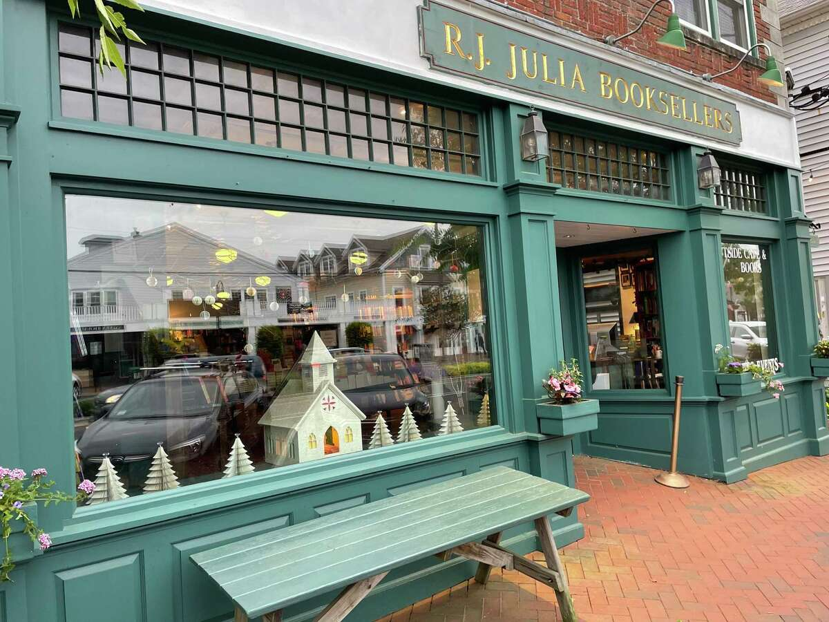 This weekend RJ Julia Booksellers will be transformed into a movie set. Outside passersby can see its windows are decorated for Christmas over Memorial Day Weekend. The store will be featured in the upcoming film adaptation of The Noel Diary by Richard Paul Evans. Filiming is also taking place in Essex.